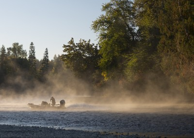 jet boat running morning mist and sun